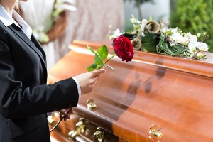 bigstock-Mourning-woman-on-funeral-with-47269159