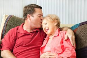 bigstock-Senior-woman-gets-a-kiss-from--50044583