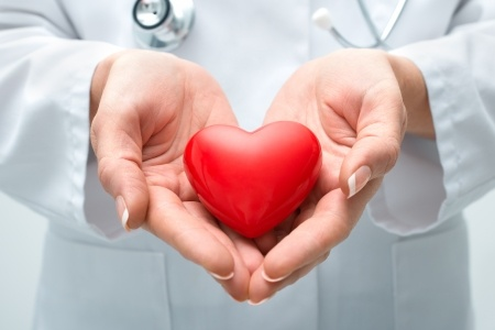23215474 - female doctor with the stethoscope holding heart